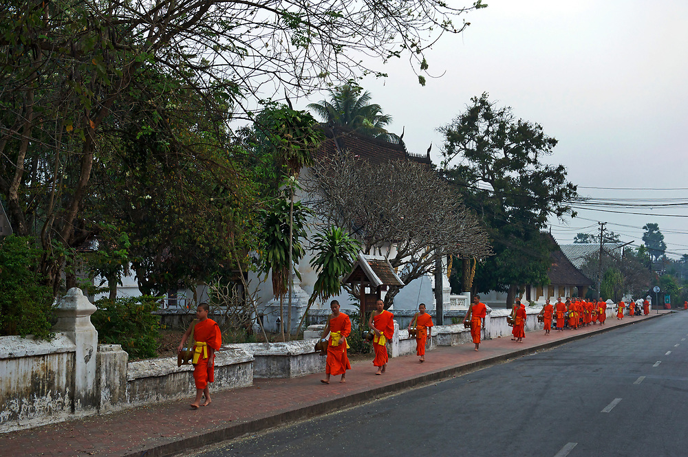 Each dawn Novice monks file around a temple circuit in Laos' old Royal Capital Luang Prabang, on the banks of the Mekong River, to collect alms from the town's residents and vistors.