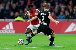 Quincy Promes #11 of Ajax and Jonas Svensson #2 of AZ Alkmaar in action during the Dutch Eredivisie match round 25 between Ajax Amsterdam and AZ Alkmaar at the Johan Cruijff Arena on March 01, 2020 in Amsterdam, Netherlands