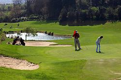 NORMANDY, FRANCE - MAY-01-2007 - Omaha Beach Golf Club - Course: La Mer (The Sea) - Hole 4 - 334 yards - Par 4...Lionel Caron of Meudon, France.and Alexandra Boleslawski, of Paris, France enjoy a day on the links at the Omaha Beach Golf Club. (Photo © Jock Fistick)