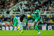 Mohamed Diame (#10) of Newcastle United and Abdoulaye Doucoure (#16) of Watford contest the ball in the air during the Premier League match between Newcastle United and Watford at St. James's Park, Newcastle, England on 3 November 2018.