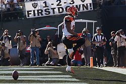 OAKLAND, CA - NOVEMBER 17: Running back Joe Mixon #28 of the Cincinnati Bengals celebrates after scoring a touchdown against the Oakland Raiders during the first quarter at RingCentral Coliseum on November 17, 2019 in Oakland, California. The Oakland Raiders defeated the Cincinnati Bengals 17-10. (Photo by Jason O. Watson/Getty Images) *** Local Caption *** Joe Mixon