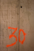 Number 30 identifies floor number on New York City construction site.