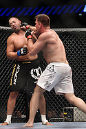 "LONDON, ENGLAND, JUNE 7, 2008: Eddie Sanchez (left) is stunned by a left jab from Antoni Hardonk during ""UFC 85: Bedlam"" inside the O2 Arena in Greenwich, London on June 7, 2008."