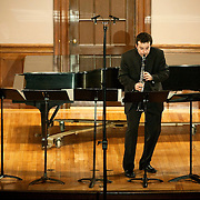 """March 4, 2012 - New York, NY :.Clarinetist Benjamin Fingland performs Helmut Lachenmann's 'Dal Niente (Interieur III)' during Counter)induction's """"works that boundary between where words leave off and music begins"""" at the Columbia University Italian Academy's neo-Renaissance-style .Casa Italiana Teatro on Sunday evening..CREDIT : Karsten Moran for The New York Times"""