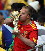 A Spanish fan kisses the World Cup during the 2010 FIFA World Cup South Africa Group H match between Spain and Switzerland at Durban Stadium on June 16, 2010 in Durban, South Africa.