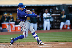 OAKLAND, CA - JUNE 14:  Ryan Rua #16 of the Texas Rangers hits an RBI sacrifice fly against the Oakland Athletics during the first inning at the Oakland Coliseum on June 14, 2016 in Oakland, California. (Photo by Jason O. Watson/Getty Images) *** Local Caption *** Ryan Rua