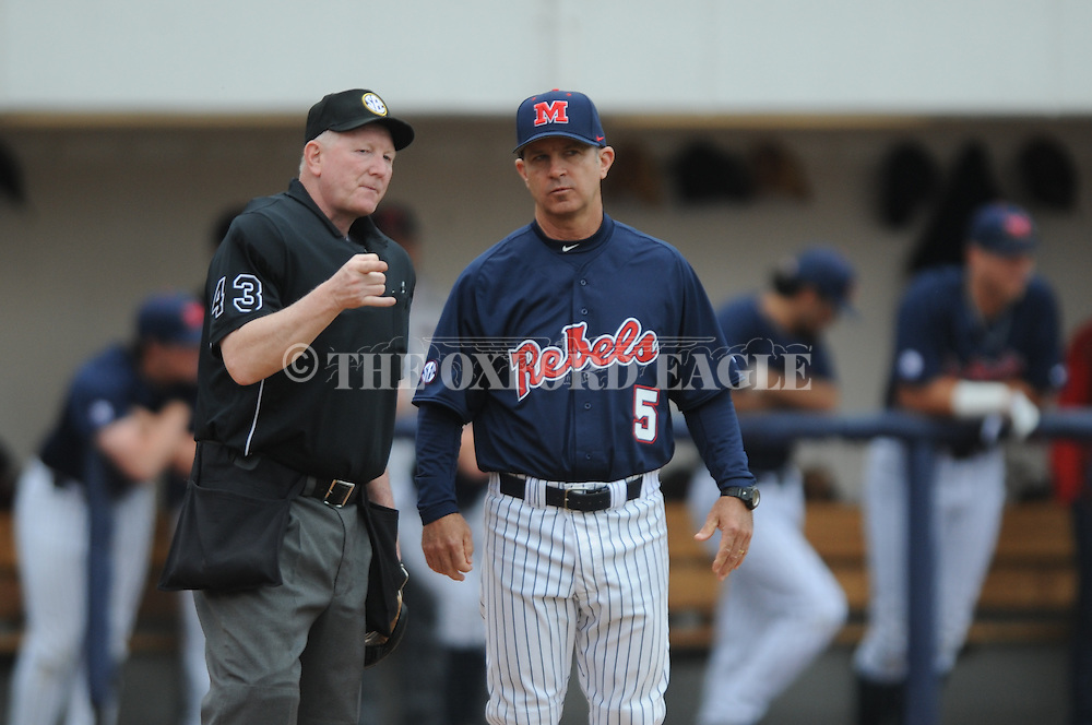 Ole Miss coach Mike Bianco talks with home plate umpire Nelson Graham at Ole Miss vs. Tennessee at Oxford-University Stadium in Oxford, Miss. on Sunday, April 5, 2015. Tennessee won 4-2.