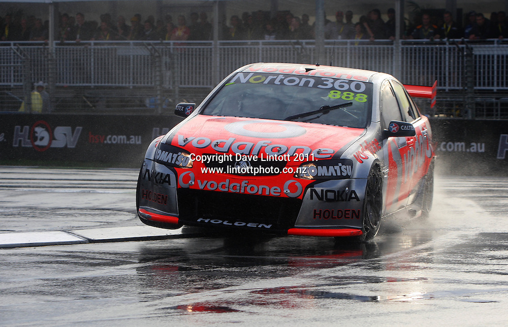 Craig Lowndes takes turn one during race one. V8 Supercars - ITM 400 day two at Hamilton Street Circuit, Hamilton, New Zealand on Saturday, 16 April 2011. Photo: Dave Lintott / photosport.co.nz