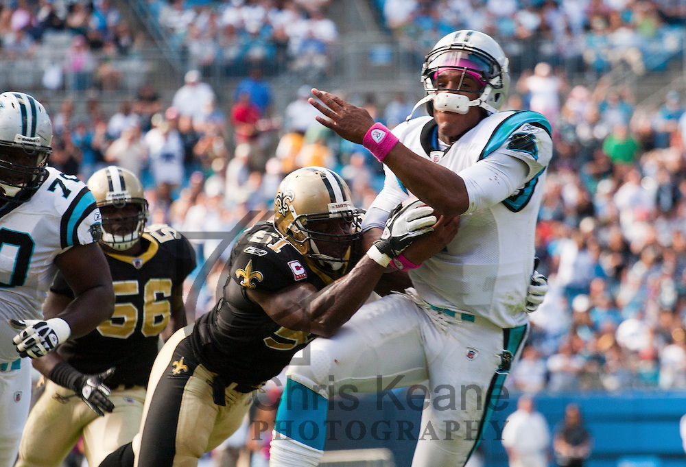 carolina panthers quarterback cam newton r is hit by new orleans