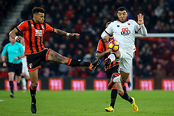 Tyrone Mings of Bournemouth lunges in to get the ball off Troy Deeney of Watford - Mandatory by-line: Jason Brown/JMP - 21/01/2017 - FOOTBALL - Vitality Stadium - Bournemouth, England - Bournemouth v Watford - Premier League