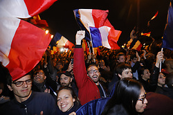 © Licensed to London News Pictures. 07/05/2017. Paris, France. Macron supporters listen the newly elected French President Emmanuel Macron's victory speech at Louvre Museum in Paris, France as he wins the second round of the presidential election agaisnt the Front National's Marine Le Pen on Sunday, 7 May 2017. Photo credit: Tolga Akmen/LNP