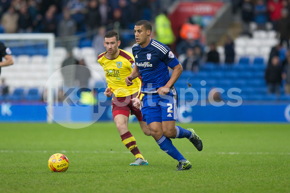 Lee Peltier of Cardiff City under the watch of David Jones of Burnley during the Sky Bet Championship match between Cardiff City and Burnley at the Cardiff City Stadium, Cardiff, Wales on 28 November 2015. Photo by Mark Hawkins.