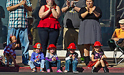Youngsters wear their firefighter helmets while taking in the Veteran's Day Parade running along S. 4th Street in Downtown Las Vegas on Tuesday, November 11, 2014. L.E. Baskow