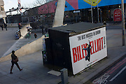 Coincidental timing of a Billy Elliot musical poster while a young skateboarder flies through the air during his acrobatic jump over steps.