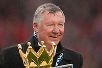 Football - Premier League 2012 / 2013 - Manchester United vs. Swansea<br /> Alex Ferguson, manager of Manchester United celebrates with the trophy at Old Trafford