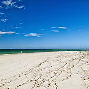 The white sandy beach of Amity Point belies its reputation as the site of several shark attacks North Stradbroke Island, just off Queensland's capital city of Brisbane, is the world's second largest sand island and, with its miles of sandy beaches, a popular summer holiday destination.
