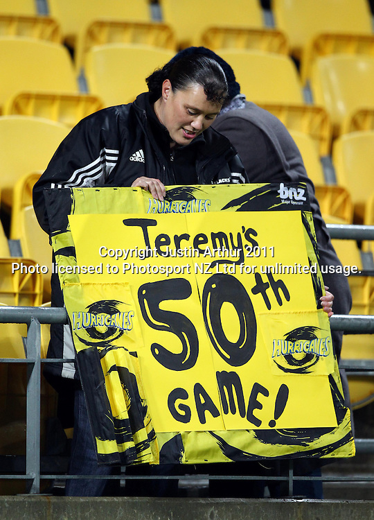 A fan holds a Jeremy Harush sign for his 50th game.Super15 rugby union match - Crusaders v Hurricanes at Westpac Stadium, Wellington, New Zealand on Saturday, 18 June 2011. Photo: Justin Arthur / photosport.co.nz