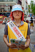 Portrait of a student working as a volunteer to promote the IAAF World Championships in Daegu. Daegu, also known as Taegu and officially the Daegu Metropolitan City, is the third largest metropolitan area in South Korea.