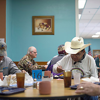 030315      Cayla Nimmo<br /> <br /> Eugene Henson, left, and Jimmie Bigloy enjoy lunch together at the North Side Senior Center in Gallup Tuesday.