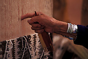 Susie Yazzie at her rug loom, Monument Valley, Navajo Tribal Park, Arizona..Subject photograph(s) are copyright Edward McCain. All rights are reserved except those specifically granted by Edward McCain in writing prior to publication...McCain Photography.211 S 4th Avenue.Tucson, AZ 85701-2103.(520) 623-1998.mobile: (520) 990-0999.fax: (520) 623-1190.http://www.mccainphoto.com.edward@mccainphoto.com