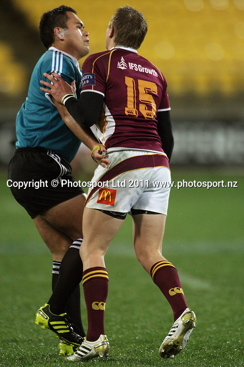 Southland kicker Robbie Robinson turns and runs into referee Sheldon Eden-Whaitiri. ITM Cup rugby union - Wellington Lions v Southland Stags at Westpac Stadium, Wellington, New Zealand on Thursday, 18 August 2011. Photo: Dave Lintott / photosport.co.nz