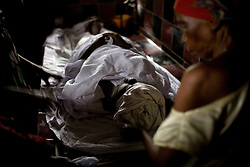 The next morning her body is carefully washed and dressed by older ladies from the community. Mommy delivered and died from postpartum bleeding in Freetown, Sierra leone.