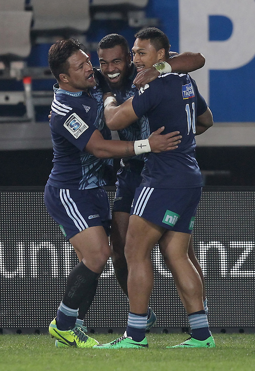 Blues' Keven Mealamu and George Moala congratulate Lolagi Visinia for scoring a try against the Hurricanes in a Super Rugby match, Eden Park, Auckland, New Zealand, Saturday, May 31, 2014.  Credit:SNPA / David Rowland