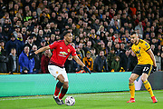 Manchester United Forward Anthony Martial battles with Wolverhampton Wanderers midfielder Romain Saiss (27) during the The FA Cup match between Wolverhampton Wanderers and Manchester United at Molineux, Wolverhampton, England on 16 March 2019.