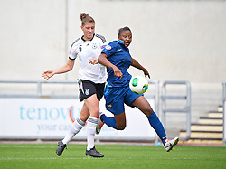 LLANELLI, WALES - Wednesday, August 28, 2013: France's Kadidiatou Diani beats Germany's Sarah Romert on her way to scoring the opening goal during the Semi-Final match of the UEFA Women's Under-19 Championship Wales 2013 tournament at Parc y Scarlets. (Pic by David Rawcliffe/Propaganda)