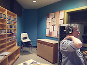 Windsor, Canada. December, 2012. 'The shake-up' with Paul Chislett, host and Rayven Howard, guest musician. CJAM is the University of Windsor radio station. 'The Shake-Up' is sponsored by OPIRG and tackles alternative news and cultural issues. Howard is an up and coming singer/songwiriter.