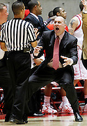 Utah head coach Jim Boylen reacts to a charging call against his team during the second half of an NCAA college basketball game, Wednesday, Jan. 19, 2011, in Salt Lake City, Utah. Utah defeated New Mexico 82-72. (AP Photo/Colin E Braley)