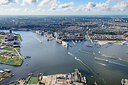 Nederland, Noord-Holland, Amsterdam, 27-09-2015;<br /> Amsterdam-Noord, NDSM-werf. met voormalige scheepshelling. Stadsontwikkeling en broedplaats in de Scheepsbouwloods. Zicht op de binnenstad en Het IJ.<br /> Amsterdam-North, former shipyard. Urban development.<br /> luchtfoto (toeslag op standard tarieven);<br /> aerial photo (additional fee required);<br /> copyright foto/photo Siebe Swart