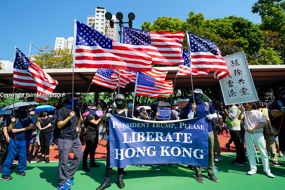 Tuen Mun, Hong Kong. 22 September 2019. Pro democracy demonstration and march through Tuen Mun in Hong Kong. Marchers protesting against harassment by sections of the pro Beijing community. Largely peaceful march had several violent incidents with police using teargas. Several arrests were made. Pictured; USA flags and banner asking President Trump for help.  Iain Masterton Live News.
