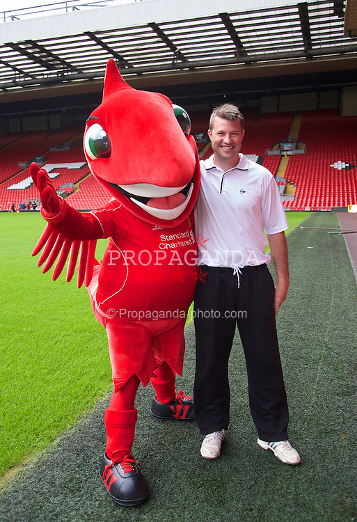 LIVERPOOL, ENGLAND - Saturday, June 21, 2014: Barry Cowan with Liverpool FC mascot Mighty Red on a visit to Anfield during Day Three of the Liverpool Hope University International Tennis Tournament. (Pic by David Rawcliffe/Propaganda)