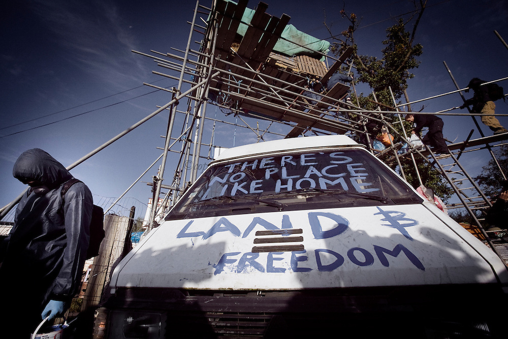 UNITED KINGDOM, Basildon:An activist paints a slogan on a van blocking the road inside Dale Farm travellers camp on September 19, 2011 in Basildon, England. © Christian Minelli.