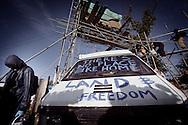 UNITED KINGDOM, Basildon:An activist paints a slogan on a van blocking the road inside Dale Farm travellers camp on September 19, 2011 in Basildon, England. © Christian Minelli.