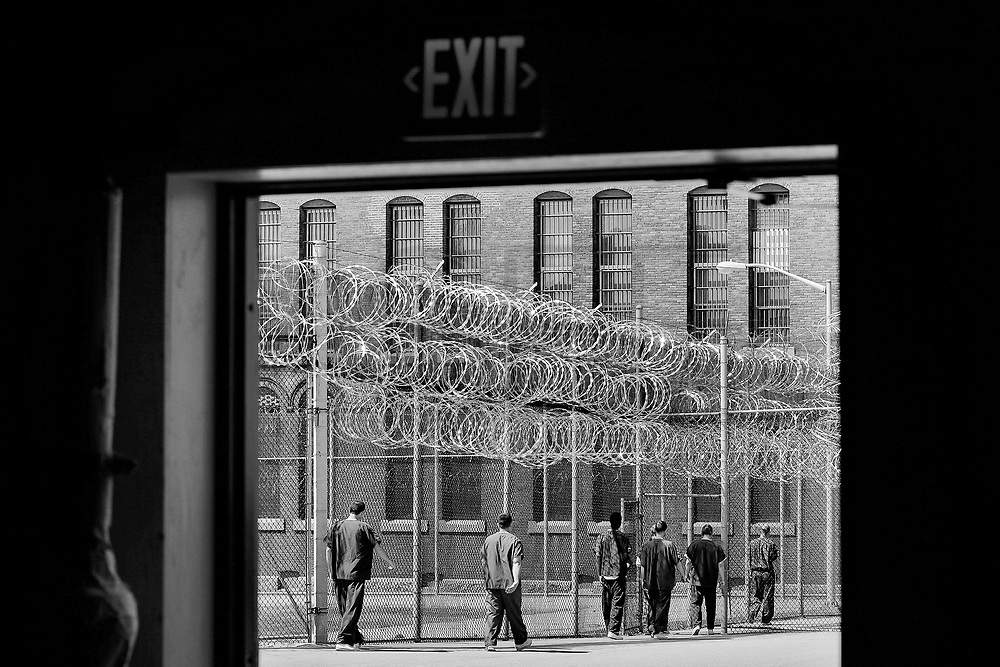 Inmates walk back to their cells after enjoying some outside time.  The Bristol County Jail & House of Correction located on Ash Street in New Bedford, Massachusetts was started in 1829, and is the oldest running jail in the United States.   The Ash street jail, as it is known, has been a controversial facility since it opened.  It is believed to be the site of the last pubic hanging in Massachusetts sometime in the 1890's.  Two big riots broke out in the 90's (1993, 1998) and since then the facility has been modified to alleviate some of the crowded conditions that resulted in the riots.