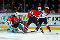 KELOWNA, BC - NOVEMBER 1: Roman Basran #30 defends the net as Sean Comrie #3 of the Kelowna Rockets checks Tyson Upper #9 of the Prince George Cougars during first period at Prospera Place on November 1, 2019 in Kelowna, Canada. (Photo by Marissa Baecker/Shoot the Breeze)