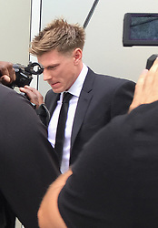 BEST QUALITY AVAILABLE Australian cricketer James Faulkner leaves Manchester Magistrate's Court, where he was banned from getting behind the wheel for two years and fined £10,000 after he admitted drink-driving.