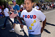 Families of the military march in the Veterans Day Parade, which honors American military veterans, in Tucson, Arizona, USA.