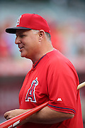 ANAHEIM, CA - MAY 17:  Manager Mike Scioscia #14 of the Los Angeles Angels of Anaheim smiles as he talks during batting practice before the game against the Tampa Bay Rays at Angel Stadium on Saturday, May 17, 2014 in Anaheim, California. The Angels won the game in a 6-0 shutout. (Photo by Paul Spinelli/MLB Photos via Getty Images) *** Local Caption *** Mike Scioscia