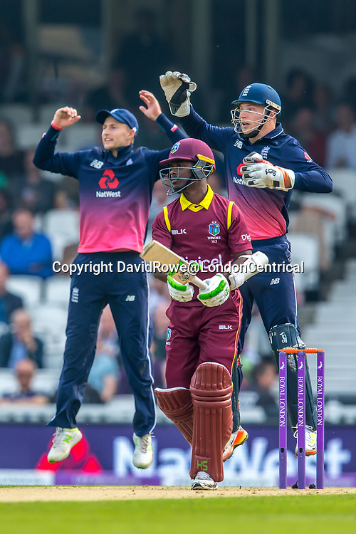 London,UK. 27 September 2017. Joe Root and Jos Butler go up but Jason Mohammed gets lucky as Morgan can't hold on to the catch. England v West Indies. In the fourth Royal London One Day International at the Kia Oval.
