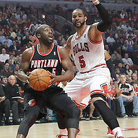 16 March 2012: Portland Trail Blazers point guard Raymond Felton (5) drives past Chicago Bulls power forward Carlos Boozer (5) during the Portland Trail Blazers 100-89 victory over the Chicago Bulls at the United Center, Chicago, Illinois, USA.