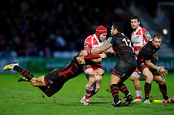 Gloucester Full Back (#15) Rob Cook is tackled by Edinburgh Outside Centre (#13) Joaquin Dominguez and Inside Centre (#12) Ben Atiga during the second half of the match - Photo mandatory by-line: Rogan Thomson/JMP - Tel: 07966 386802 - 15/12/2013 - SPORT - RUGBY UNION - Kingsholm Stadium, Gloucester - Gloucester Rugby v Edinburgh Rugby - Heineken Cup Round 4.