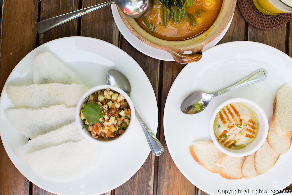 Silk worm and green mango salad served with prawn crackers (left), vegetable curry (center/top) and lotus seed, jackfruit and coriander hummus (right) at Marum, a hospitality training restaurant for disadvantaged Cambodian youth. Siem Reap, Cambodia