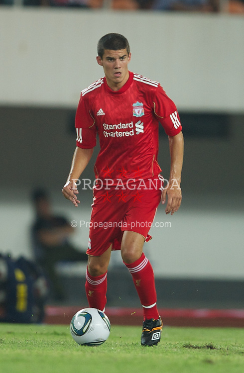 GUANGZHOU, CHINA - Wednesday, July 13, 2011: Liverpool's Conor Coady in action against Guangdong Sunray Cave during the first pre-season friendly on day three of the club's Asia Tour at the Tianhe Stadium. (Photo by David Rawcliffe/Propaganda)