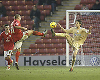 Photo: Aidan Ellis.<br /> Barnsley v Bristol City. Coca Cola League 1. 04/02/2006.<br /> Bristol's Cole Skuse and Barnsley's Marc Richards compete for Possesion