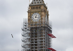 © Licensed to London News Pictures. 10/10/2017. Big Ben is almost hidden by scaffolding as The Elizabeth Tower - home of the Big Ben bell is readied for conservation work.  The work is part of a three-year programme to conserve the Great Clock, the tower and Big Ben at The Houses of Parliament. London, UK. Photo credit: Peter Macdiarmid/LNP