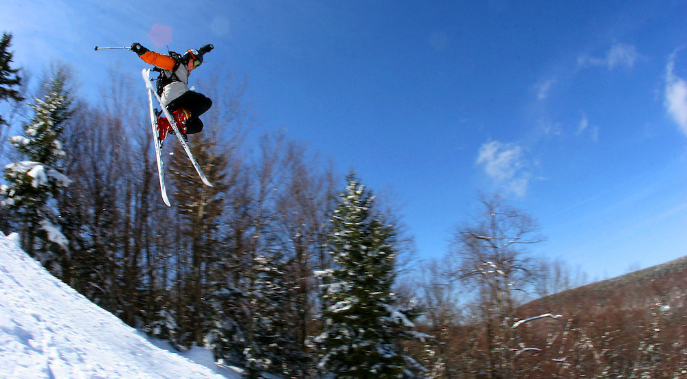 Todd, a member of the Snowcats, takes advantage of the only sunny day on Snowshoe by showing off his moves at the terrain park.