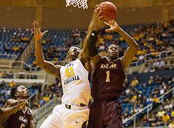 Dec 13, 2015; Morgantown, WV, USA; West Virginia Mountaineers forward Devin Williams (41) and Louisiana Monroe Warhawks forward Travis Munnings (1) jump for a rebound during the first half at WVU Coliseum. Mandatory Credit: Ben Queen-USA TODAY Sports